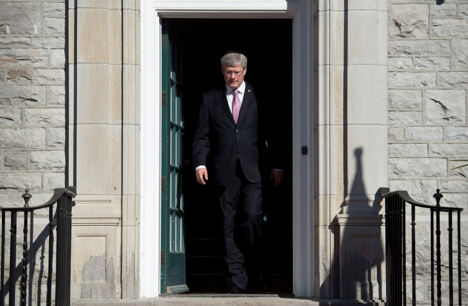 Prime Minister Stephen Harper steps out of his residence at 24 Sussex drive Monday June 9, 2014 in Ottawa.  (THE CANADIAN PRESS / Adrian Wyld)