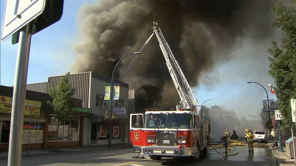 Firefighters spent hours battling a blaze that tore through four businesses in Port Coquitlam Thursday morning. July 30, 2015. (CTV)
