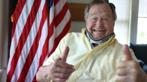 In this Thursday, July 30, 2015, photo provided by the Office of George H. W. Bush, former President George H.W. Bush wears a neck brace at his summer home in Kennebunkport, Maine. The 91-year-old tweeted the photo showing him in the brace and giving two thumbs up Thursday. Bush fractured a bone in his neck when fell there on July 15. (Office of George H. W. Bush via AP)