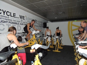 In this Friday, Jan. 17, 2014 file photo, people participate in a SoulCycle workout session. (AP / Nekesa Mumbi Moody)