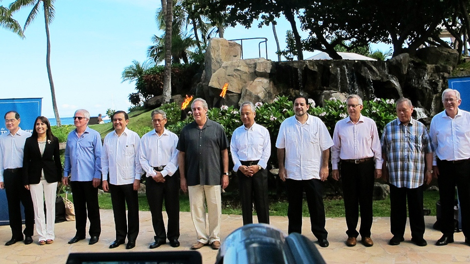 Trade ministers from 12 Pacific Rim nations negotiating the Trans-Pacific Partnership agreement pose for a group photo at a meeting in Lahaina, Hawaii on Thursday, July 30, 2015. (AP / Audrey McAvoy)