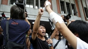 Student protesters against changes to their curriculum shout slogans as they occupy the area inside the gates of the Ministry of Education in Taipei, Taiwan on July 31, 2015. (AP / Wally Santana)