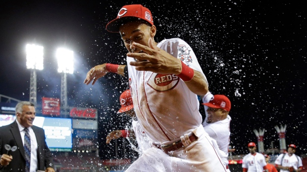Cincinnati Reds' Billy Hamilton, foreground, is doused by Brayan Pena, center right, after a baseball game against the Pittsburgh Pirates, Thursday, July 30, 2015, in Cincinnati. The Reds won 15-5. (AP / John Minchillo)