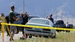 Law enforcement agents investigate the scene of a shooting in Pryor, Mont., on the Crow Reservation on Wednesday, July 29, 2015. (Casey Page / The Billings Gazette)