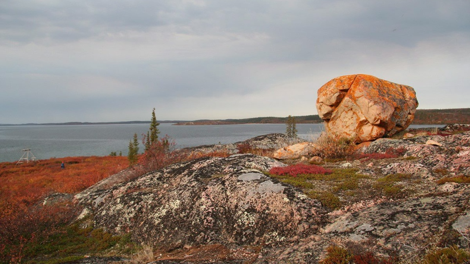 In this handout photo, a lichen-covered rock sits on an outcrop on the shore of Artillery Lake in an area within the boundaries of the proposed Thiadene Nene park in the Northwest Territories. (David Murray/Parks Canada-HO)