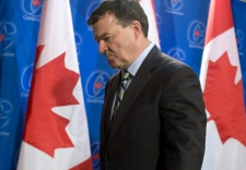 Finance Minister Jim Flaherty leaves a media availability following caucus meetings at the Conservative convention in Winnipeg, Thursday, Nov. 13, 2008. (Adrian Wyld / THE CANADIAN PRESS)