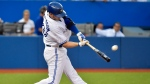 Toronto Blue Jays third baseman Josh Donaldson hits a solo homerun against the Kansas City Royals during fourth inning AL baseball action in Toronto on Thursday, July 30, 2015. (Nathan Denette/THE CANADIAN PRESS)