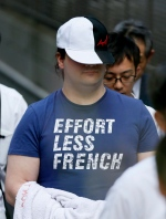 Japan police arrest Mark Karpeles, the Mt. Gox CEO on Saturday, Aug. 1, 2015, in Tokyo. Karpeles, was arrested Saturday on suspicion of inflating his cash account by $1 million. (AP/Kyodo News)