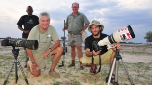 Researcher Brent Stapelkamp, front right, poses with colleagues in Hwange National Park, Zimbabwe on Nov. 9, 2014. Stapelkamp, who was part of a team that studied Cecil the lion for nine years, says there is 'no excuse' for the animal's death. (Derek Whalley/AP Photo)