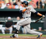 Detroit Tigers' Yoenis Cespedes follows through on a single against the Baltimore Orioles in the first inning of a baseball game, Thursday, July 30, 2015, in Baltimore. (AP / Gail Burton)