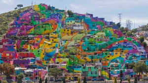 Hundreds of houses painted in bright colors is part of a government-sponsored project is called Pachuca Paints Itself, in the Palmitas neighborhood, in Pachuca, Mexico, Thursday, July 30, 2015. (Sofia Jaramillo/AP Photo)