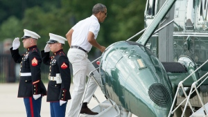 President Barack Obama boards Marine One at Andrews Air Force Base, Md., Saturday, Aug. 1, 2015, for a short trip to Camp David, after playing golf. In what has become an annual birthday tradition, the president started celebrating on Saturday by taking a trio of friends from his Hawaii childhood for a golf outing at Andrews Air Force Base. (AP / Andrew Harnik)