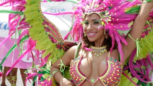 Masqueraders in bright, colourful costumes march during the Scotiabank Caribbean Carnival's Grand Parade in Toronto, on Aug. 1, 2015. (Trevor Koroll / CTVNews.ca)