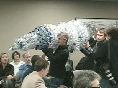 Residents use as tree-like structure made out of plastic cups to protest the use of wasteful packaging at councillors committee meeting on Wednesday, Nov. 12, 2008.