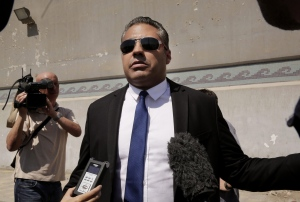 Canadian Al-Jazeera English journalist Mohamed Fahmy, speaks to the media in front of Tora prison, in Cairo, Egypt, Thursday, July 30, 2015. Egyptian judicial officials say a Cairo court has postponed the verdict in the retrial of three Al-Jazeera English reporters until Aug. 29. (Nariman El-Mofty / THE CANADIAN PRESS)