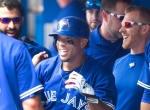 Toronto Blue Jays' Ben Revere all smiles in the dugout after he hit a sacrifice fly in the eighth inning of their AL baseball game against the Kansas City Royals in Toronto on Sunday, August 2, 2015. (THE CANADIAN PRESS/Fred Thornhill)