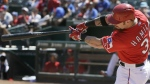 Texas Rangers' Josh Hamilton follows through on his swing, hitting a two-run home run during the seventh inning of a baseball game against the San Francisco Giants in Arlington, Texas on Aug. 2, 2015. (AP / LM Otero)