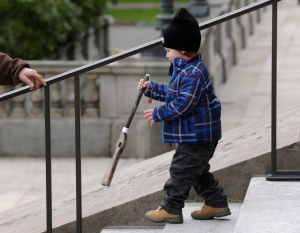 Joseph Sherman, 3, carries a toy pop gun as he walks with his grandfather at a gun-rights rally at the Capitol in Olympia, Wash. on Thursday, Jan. 15, 2015. (AP / Ted S. Warren)