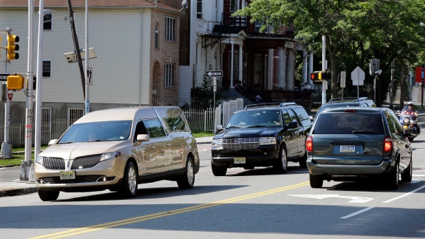 A gold colored hearse carrying the coffin bearing the body of Bobbi Kristina Brown drives near Whigham Funeral home in Newark, N.J., early Monday, Aug. 3, 2015. Bobbi Kristina, the only child of Whitney Houston and R&B singer Bobby Brown, died in hospice care July 26. (AP / Mel Evans)