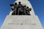 The National War Memorial, with the dates marking the First World War, is seen in Ottawa on Nov. 11, 2014. (THE CANADIAN PRESS / Sean Kilpatrick)