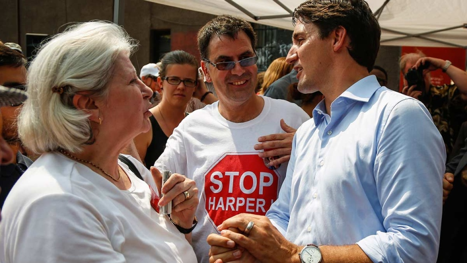 Liberal Leader Justin Trudeau, right, greets supporters during a campaign stop in Calgary, Monday, Aug. 3, 2015. (Jeff McIntosh / THE CANADIAN PRESS)