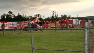 Officials investigating tent collapse that killed 2, injured 22