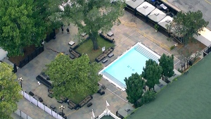 Aerial view of Muzik nightclub on the grounds of Exhibition Place in downtown Toronto as police investigate the crime scene, Tuesday morning, Aug. 4, 2015.