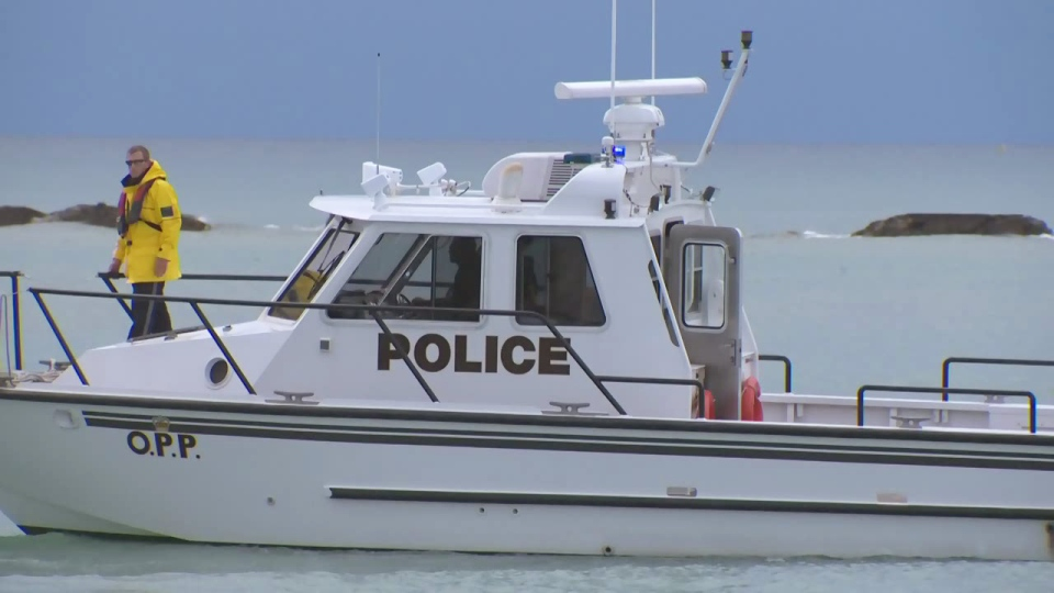An OPP boat searches for a missing swimmer near Station Beach in Kincardine on Sunday, Aug. 2, 2015.