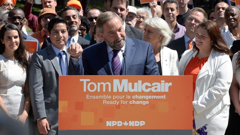 NDP Leader Tom Mulcair delivers a speech during a campaign stop in Montreal on Tuesday, Aug. 4, 2015. (Ryan Remiorz / THE CANADIAN PRESS)