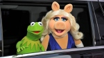 "Kermit the Frog, left, and Miss Piggy arrive at the World Premiere of ""Muppets Most Wanted,"" in Los Angeles, on Tuesday, March 11, 2014. (Photo by Richard Shotwell/Invision/AP)"