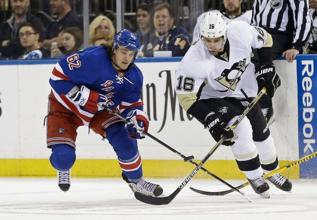 0b1007579e9 New York Rangers' Carl Hagelin (62) and Pittsburgh Penguins' Brandon Sutter  (16) fight for control of the puck during the first period of Game 5 in the  ...