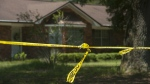 Investigative tape is seen near a home in Pensacola, Fla. on Aug. 3, 2015. A triple homicide in Florida is being investigated as a possible ritualistic killing connected to the recent blue moon, Escambia County Sheriff David Morgan said Tuesday, Aug. 4. (Tony Giberson / The Pensacola News Journal)