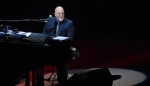 Billy Joel performs at the Nassau County Veterans Memorial Coliseum on Tuesday, Aug. 4, 2015, in Uniondale, N.Y. (Thomas A. Ferrara/Newsday via AP)
