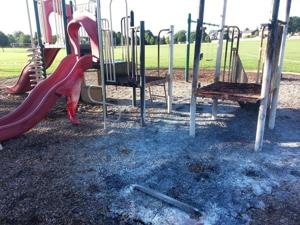 A playground set was destroyed by a suspicious fire in southwest London, Ont. on Wednesday, Aug. 5, 2015. (Justin Zadorsky / CTV London)