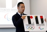 Japanese designer Kenjiro Sano gives a detailed explanation of how he came up with his logo for the 2020 Tokyo Olympics at a press conference in Tokyo, Wednesday, Aug. 5, 2015.(AP / Ken Aragaki)