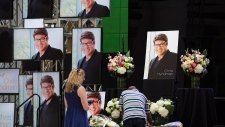 Visitors pay their respects to Chris Hyndman