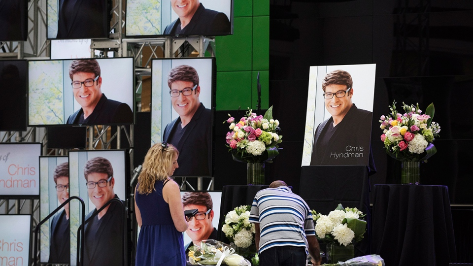 Visitors pay their respects to Chris Hyndman of the CBC show 'Steven and Chris' at a public memorial at the CBC Broadcast Centre in Toronto on Wednesday, Aug.  5, 2015. (Aaron Vincent Elkaim / THE CANADIAN PRESS)