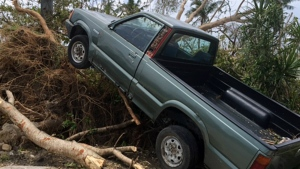This photo provided by Svetlana Hunter to the Associated Press shows the storm damage to a vehicle in Saipan, Northern Mariana Islands on Aug. 5, 2015. (Svetlana Hunter)