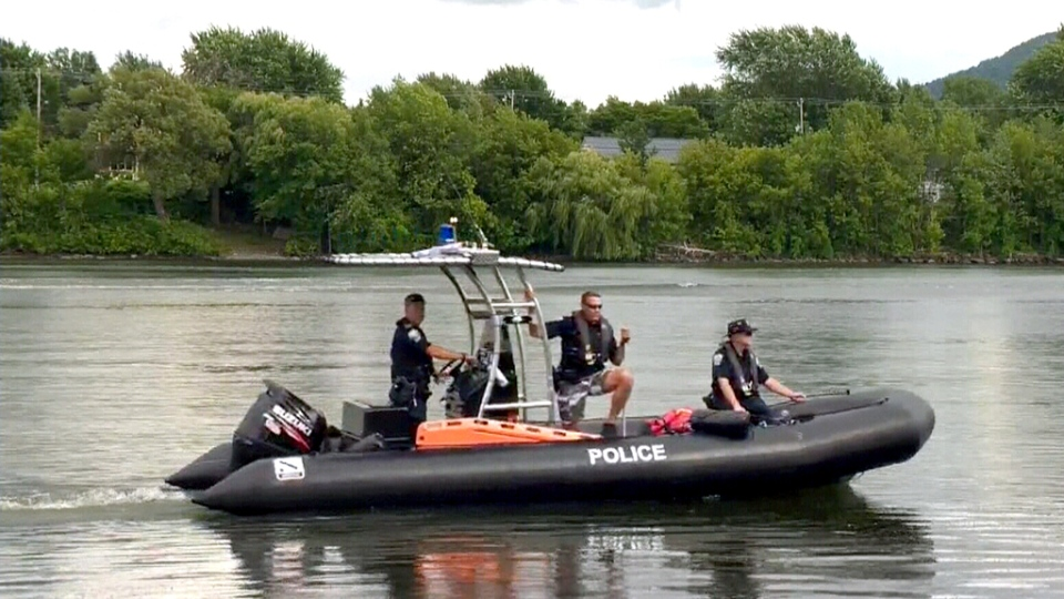 Richelieu Police search the Richelieu River by boat.