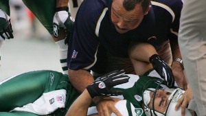 In this Sunday, Nov. 6, 2005, file photo, New York Jets' Wayne Chrebet lies unconscious while a San Diego Chargers trainer looks over him after he took a hit on a reception during the fourth quarter of an NFL football game, in East Rutherford, N.J. (AP / Tim Larsen, File)