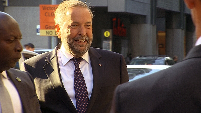 NDP Leader Thomas Mulcair arrives in Toronto for the first federal leaders' debate, Thursday, Aug. 6, 2015.