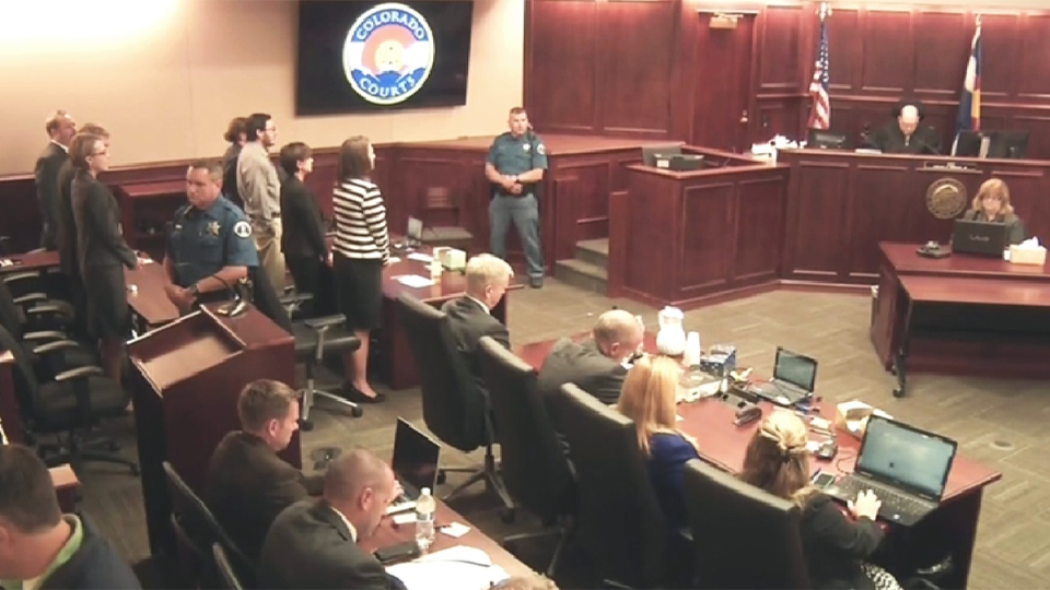 James Holmes is sentenced to life in prison without the possibility of parole in a courtroom in Centennial, Colo., Friday, Aug. 7, 2015.