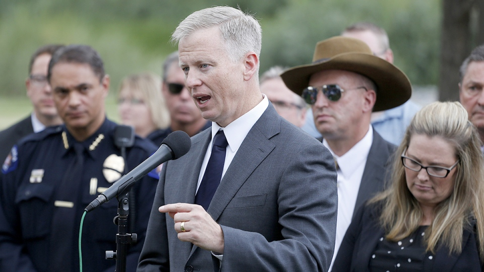 District Attorney George Brauchler speaks with members of the media following the reading of the jury's decision that Colorado theater shooter James Holmes will not receive the death penalty, outside the Arapahoe County District Court in Centennial, Colo., Friday, Aug. 7, 2015. (AP / Brennan Linsley)