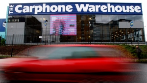 This is a Monday, Dec. 8, 2008 file photo of a car as it passes the offices of Carphone Warehouse in London. UK cellphone retailer Carphone Warehouse says personal details of up to 2.4 million customers may have been accessed after the company was hit by a cyber-attack, discovered Wednesday, August 5, 2015. (AP Photo/Kirsty Wigglesworth, File)