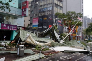 A street corner is filled with a mangled rooftop brought down by strong winds from Typhoon Soudelor in Taipei, Taiwan, Saturday, Aug. 8, 2015. (AP / Wally Santana)