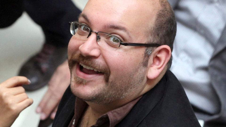 Jason Rezaian, an Iranian-American correspondent for the Washington Post, smiles as he attends a presidential campaign of President Hassan Rouhani in Tehran, Iran, April 11, 2013. (AP / Vahid Salemi, File)