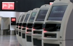 Check-in kiosks sit unused at the Qantas domestic terminal at Sydney Airport in Sydney, Saturday, Oct. 29, 2011. (AP / Rick Rycroft)