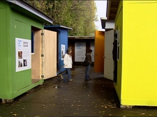 Visitors tour the 64-square-foot housing project on Vancouver's Granville Island.