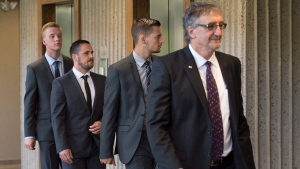 Craig Stoner, Simon Radford and Joshua Finbow, left to right, follow lawyer Mark Knox at Nova Scotia Supreme Court in Halifax on August 11, 2015. (Andrew Vaughan / THE CANADIAN PRESS)