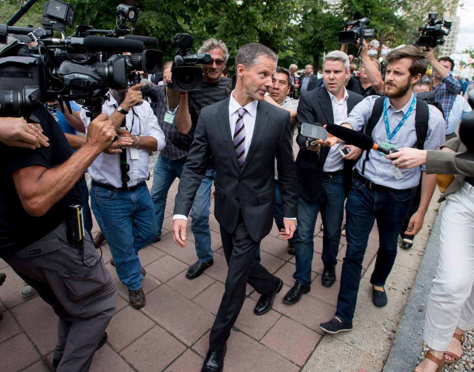 Nigel Wright, former Chief of Staff to Prime Minister Stephen Harper, leaves the courthouse in Ottawa after his first day of testimony in the trial of Mike Duffy on Wednesday, Aug. 12, 2015. (Justin Tang / THE CANADIAN PRESS)